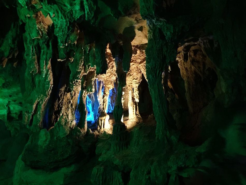 Caves in cave Caves Colors Lights Rocks Rock Formations Geology Geometric Shape Geometric Abstraction Underground HuangLongCave Huanglongdong Zhangjiajie Hunan China Travel 43 Golden Moments Colour Of Life Pivotal Ideas Eyeemphoto