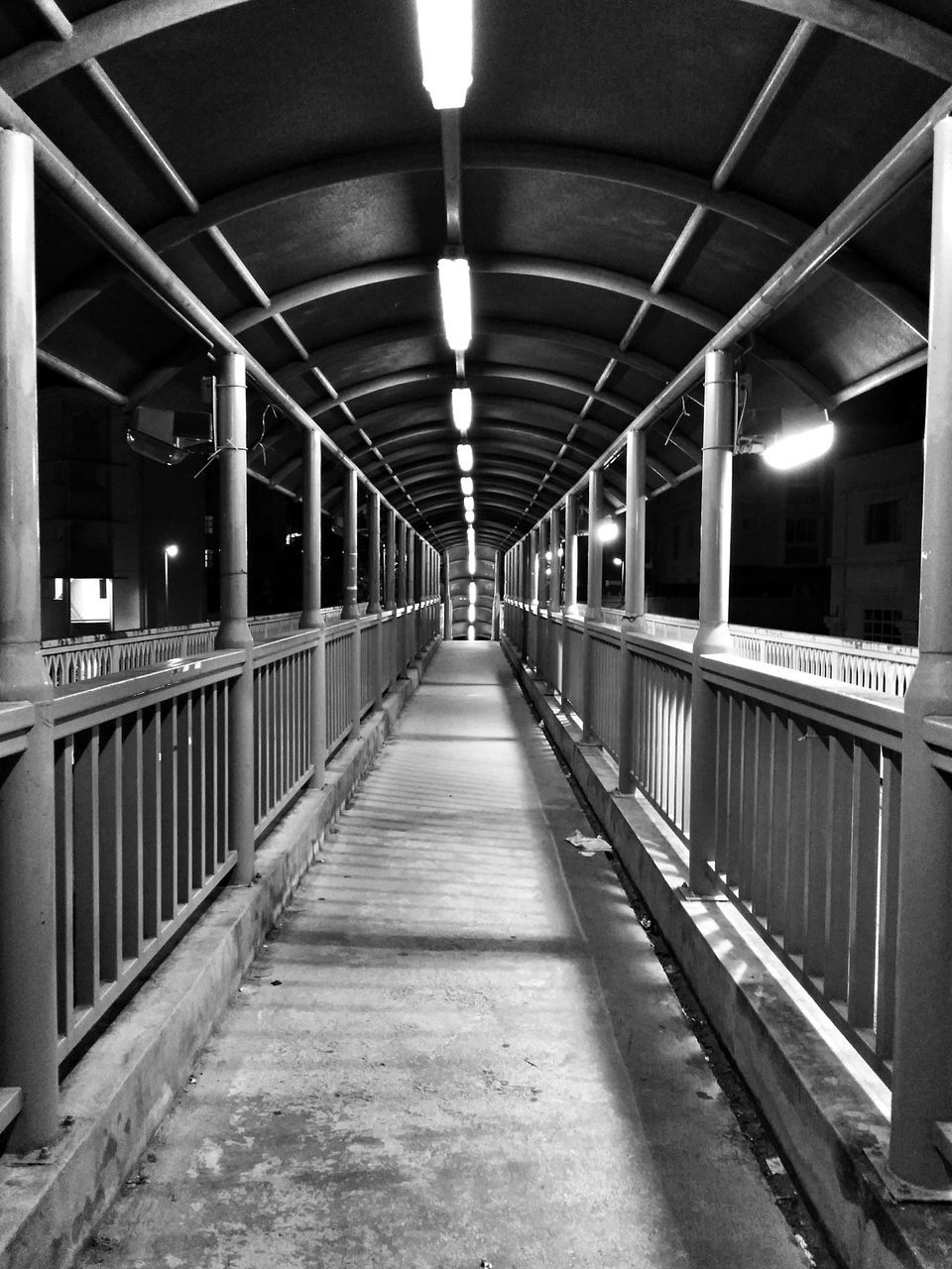 illuminated, lighting equipment, the way forward, night, ceiling, railing, indoors, built structure, transportation, architecture, no people