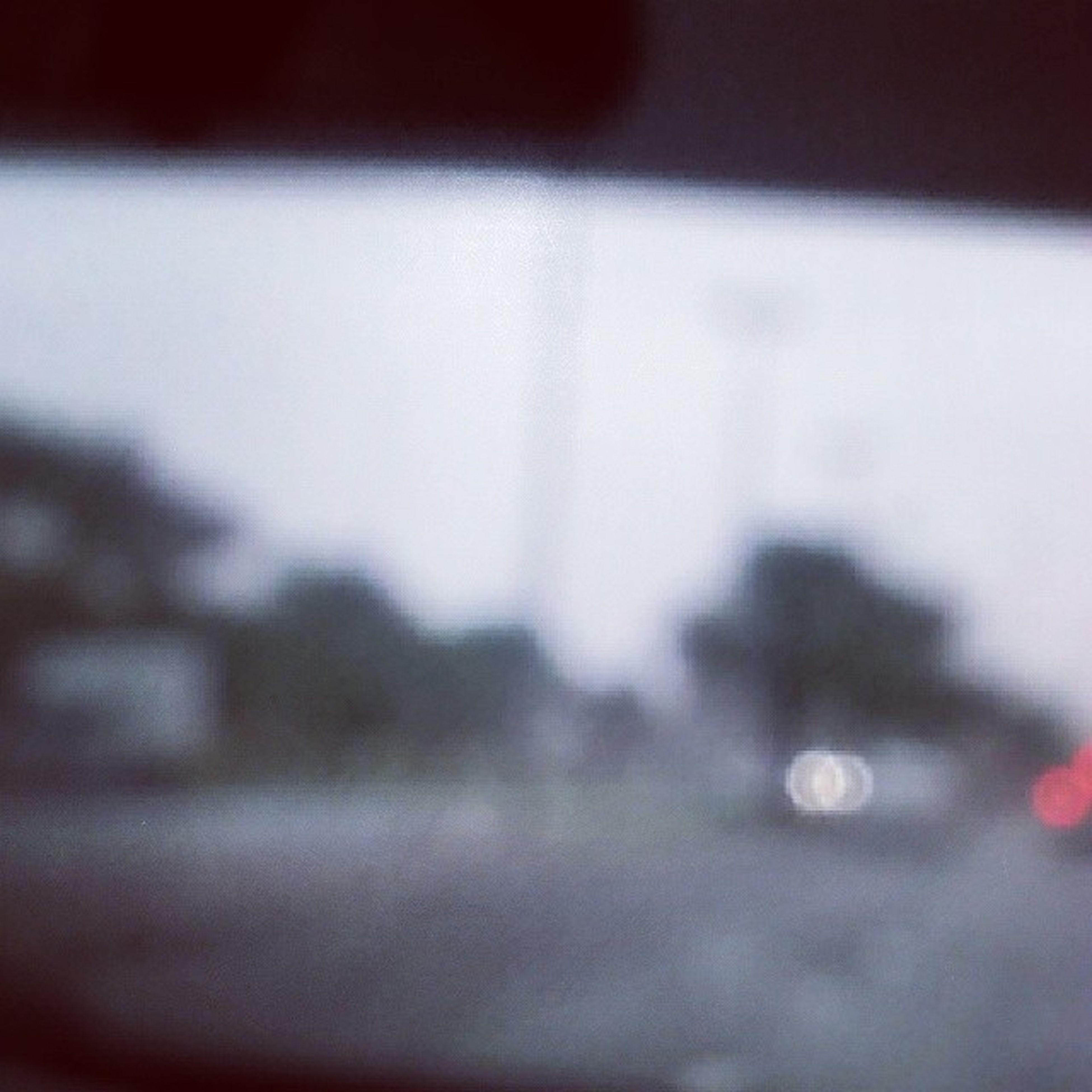 selective focus, defocused, focus on foreground, indoors, close-up, drop, surface level, window, blurred, built structure, wet, rain, architecture, no people, weather, day, dusk, building exterior, glass - material