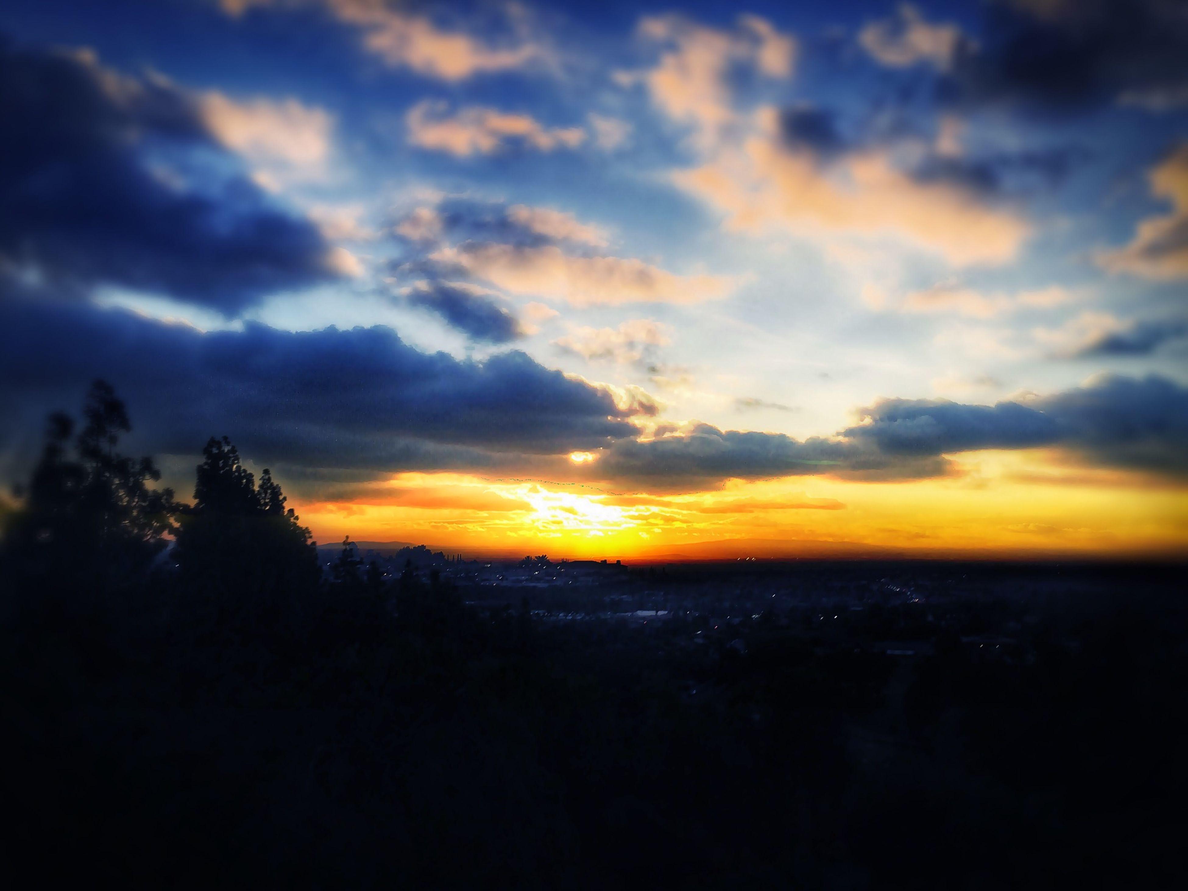 sunset, silhouette, scenics, orange color, sky, beauty in nature, tranquil scene, tranquility, idyllic, cloud - sky, nature, dramatic sky, landscape, dark, cloud, tree, sun, majestic, moody sky, outdoors