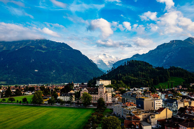 Architecture Beauty In Nature Blue Building Exterior Built Structure Cloud Cloud - Sky Day Green Color Interlaken Jungfrau Jungfrau - Top Of Europe Mountain Mountain Range Outdoors Physical Geography Residential District Scenics Sky Switzerland Town Tranquil Scene Tranquility Travel Destinations Tree