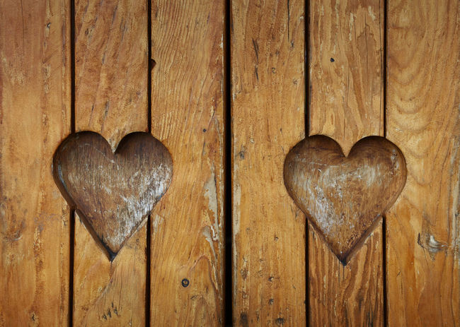 Two wooden hearts shaped carved in vintage grunge wooden planks of rustic window blinds as symbol of love, romance and togetherness Background Carved Close-up Couple Crafts Craftsmanship  Decoration Feelings Heart Shape Hearts Love Old Planks Romance Romantic Rustic Together Two Valentine Valentine's Day  Vintage Window Blinds Window Shutter Wood - Material Wooden
