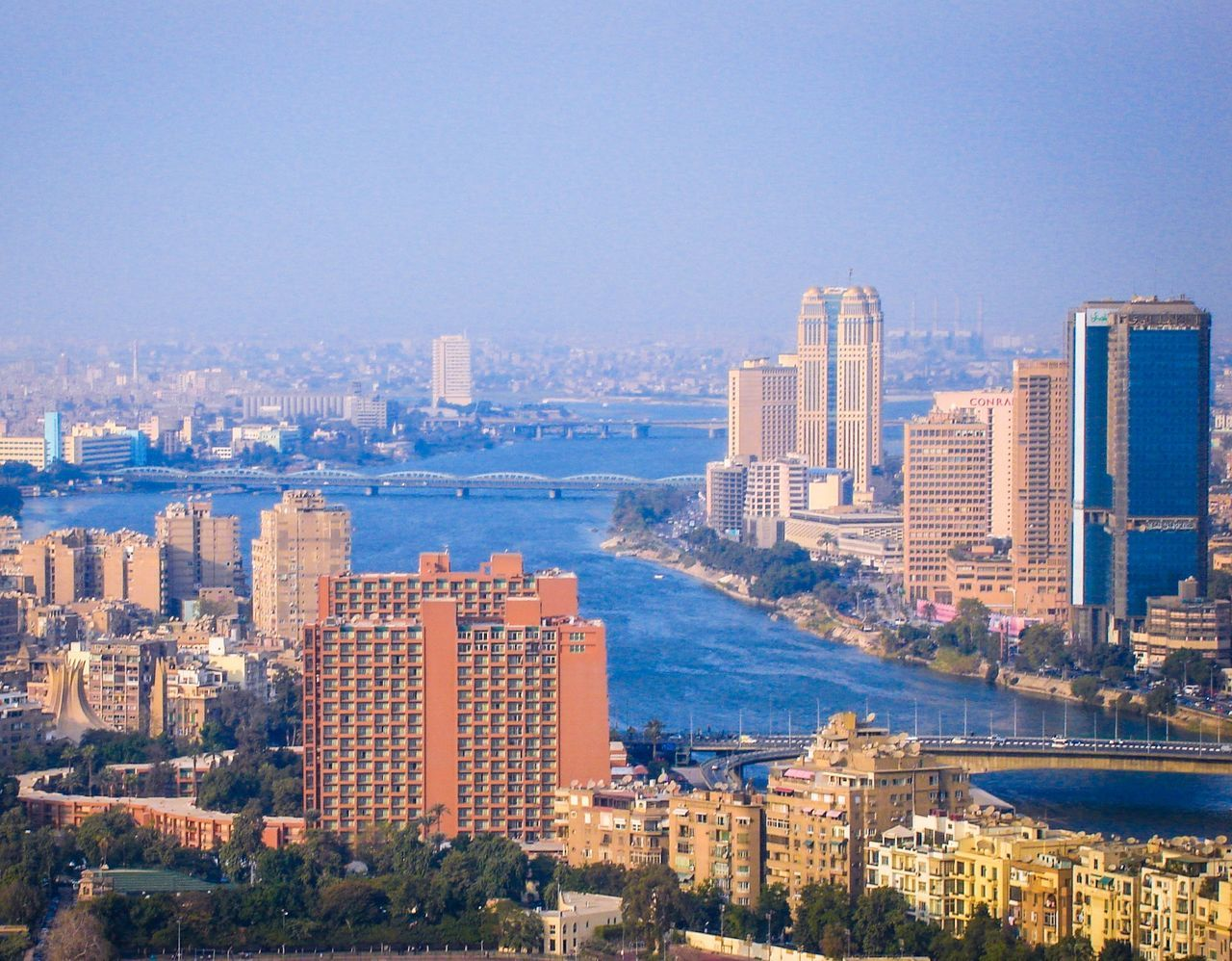 Glamorous Cairo City Cityscape Skyscraper Architecture Urban Skyline Building Exterior Modern Sea Business Finance And Industry Sky Travel Destinations Outdoors Travel Clear Sky No People Aerial View Downtown District Development Office Building Exterior Harbor Cairo Egypt Cairo Tower Cairo City Cairo Streets Cairobeauty Miles Away
