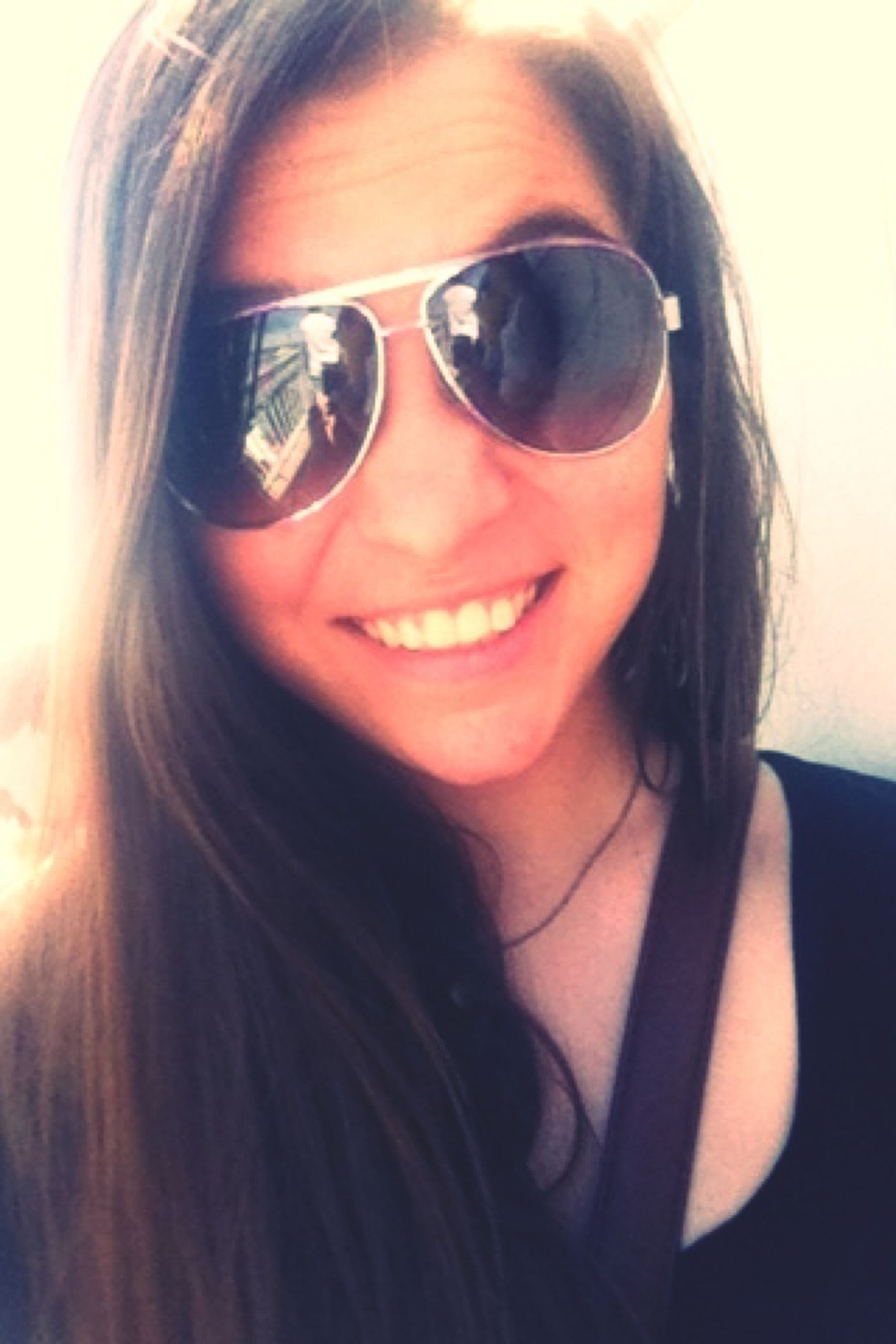 young women, young adult, headshot, looking at camera, person, portrait, lifestyles, long hair, leisure activity, front view, indoors, head and shoulders, close-up, sunglasses, smiling, brown hair