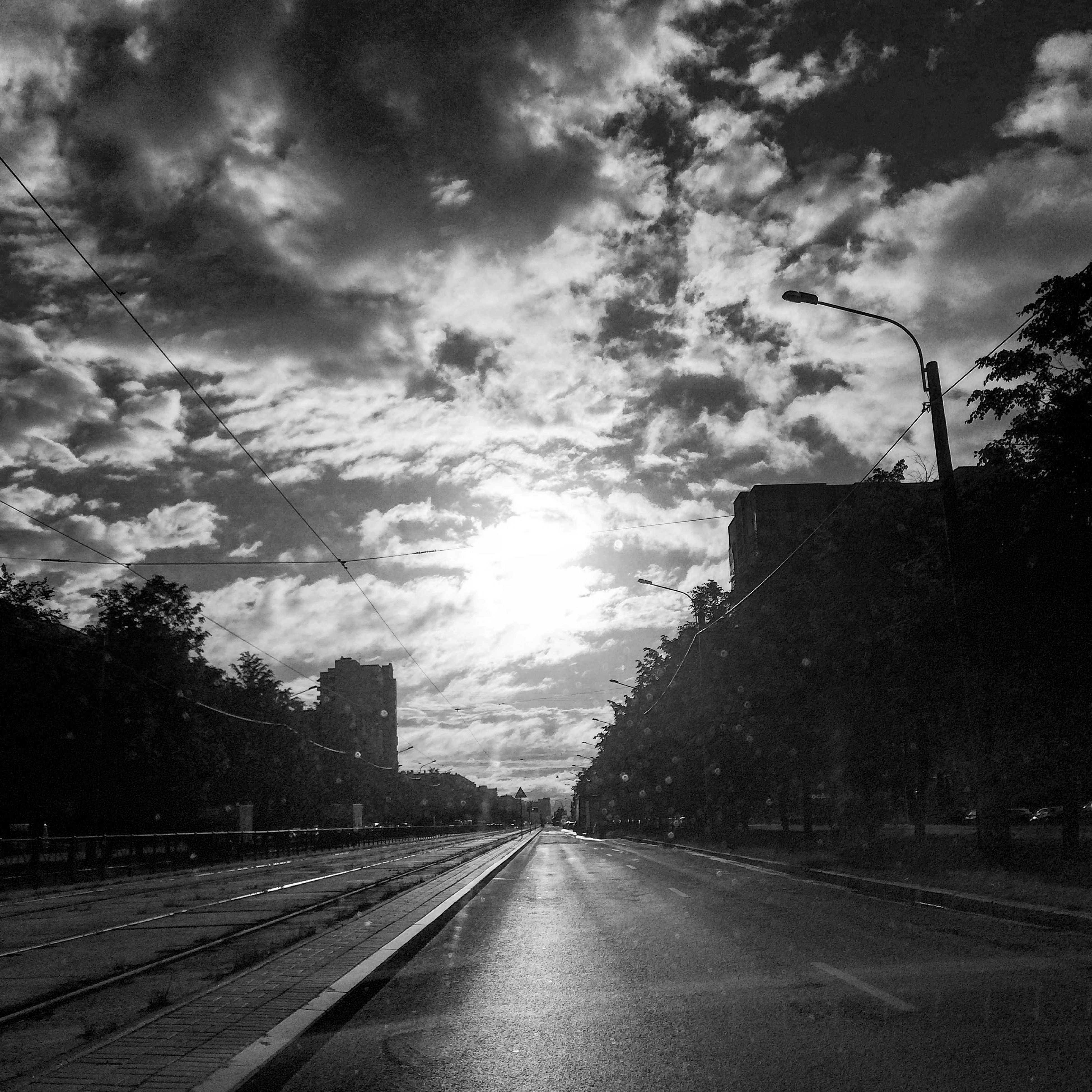 the way forward, sky, cloud - sky, road, diminishing perspective, transportation, vanishing point, cloudy, cloud, tree, street, empty road, country road, empty, nature, road marking, outdoors, tranquility, sunlight, weather