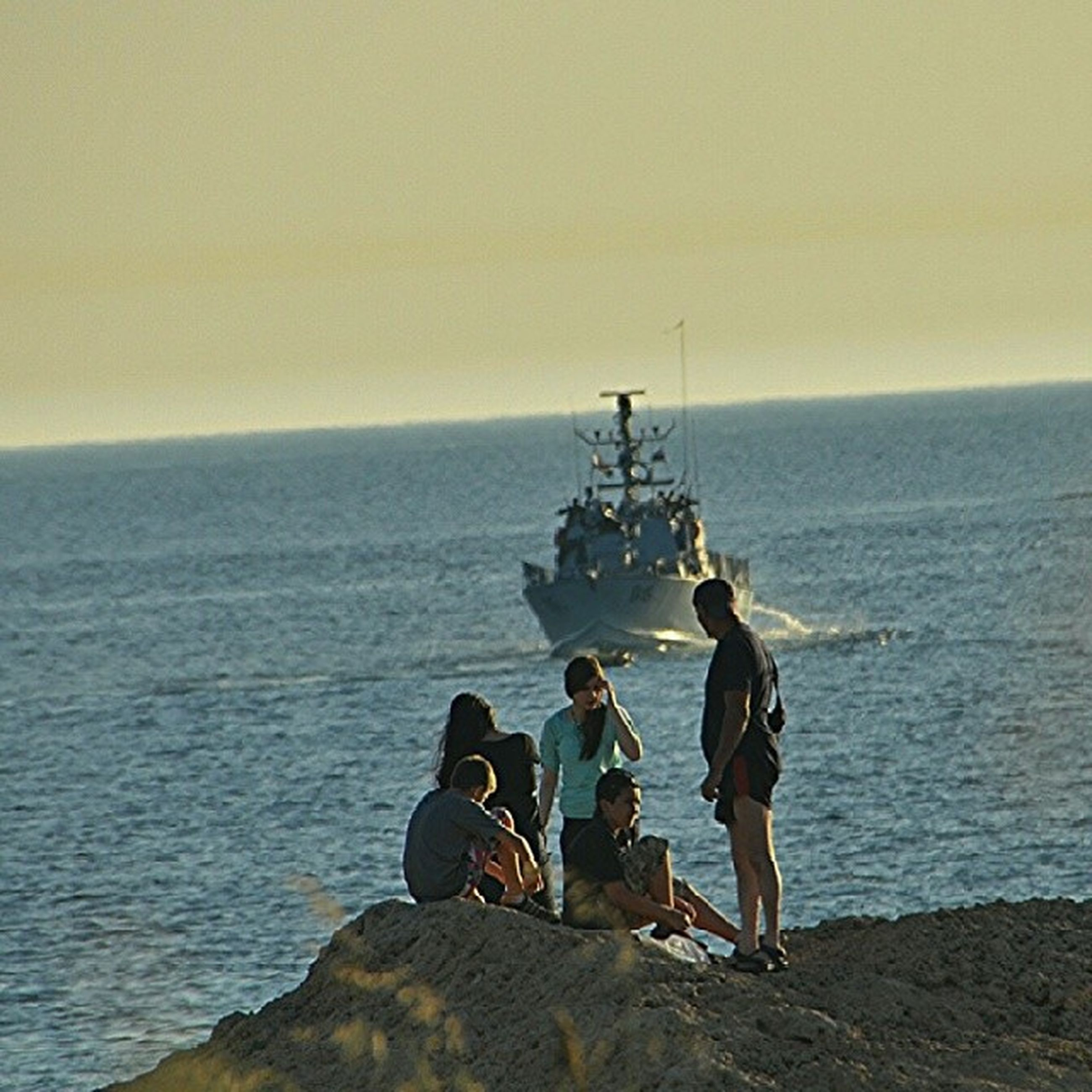 sea, horizon over water, water, men, lifestyles, leisure activity, sky, scenics, nautical vessel, nature, beauty in nature, fishing, vacations, togetherness, tranquility, tranquil scene, beach, standing