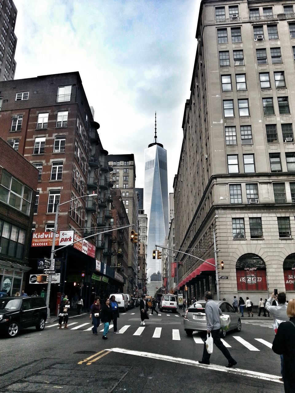 city, architecture, street, walking, building exterior, road, modern, pedestrian, group of people, sky, outdoors, day, people