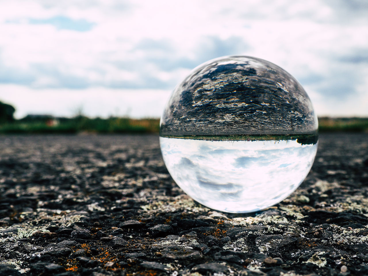 sphere, crystal ball, close-up, reflection, focus on foreground, no people, sky, ball, outdoors, tranquility, crystal, day, nature, landscape, water, fragility