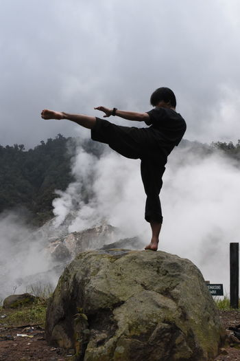 fighter in mount salak bogor indonesia Fighter Pencak Silat Silat INDONESIA Kpsnusantara Adult Adults Only One Person Full Length Sportsman Strength Athlete