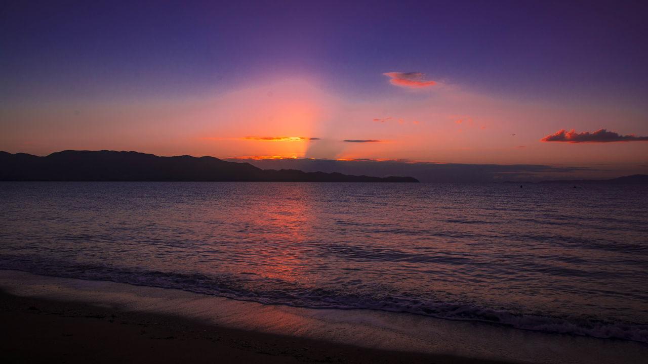 Beauty In Nature Calm Cloud Cloud - Sky Coastline Enjoying Life Idyllic Majestic Mountain Nature Ocean Orange Color Outdoors Rippled Scenics Sea Sky Sun Sunrise Taking Photos Tranquil Scene Tranquility Travel Destinations Water