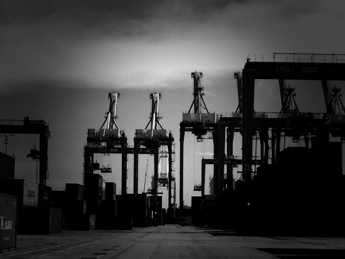 Crane - Construction Machinery Industry Freight Transportation Commercial Dock Industrial Equipment Cargo Container Shipyard Crane Construction Site Built Structure Development Architecture Cloud - Sky Outdoors Harbor Shipping  No People Transportation Evil Empire The Machine Machines