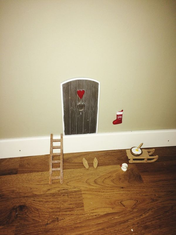 SantaClaus coming through his own door in the wall.. No People Christmastime Santa Claus Door In A Wall