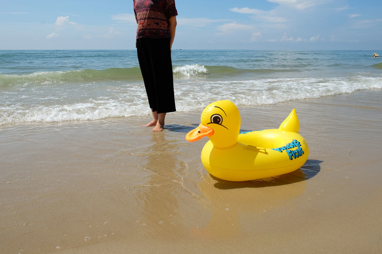 Day Outdoors Sea People Duck Toy Duck Seaside Standing Vacations Yellow Live For The Story