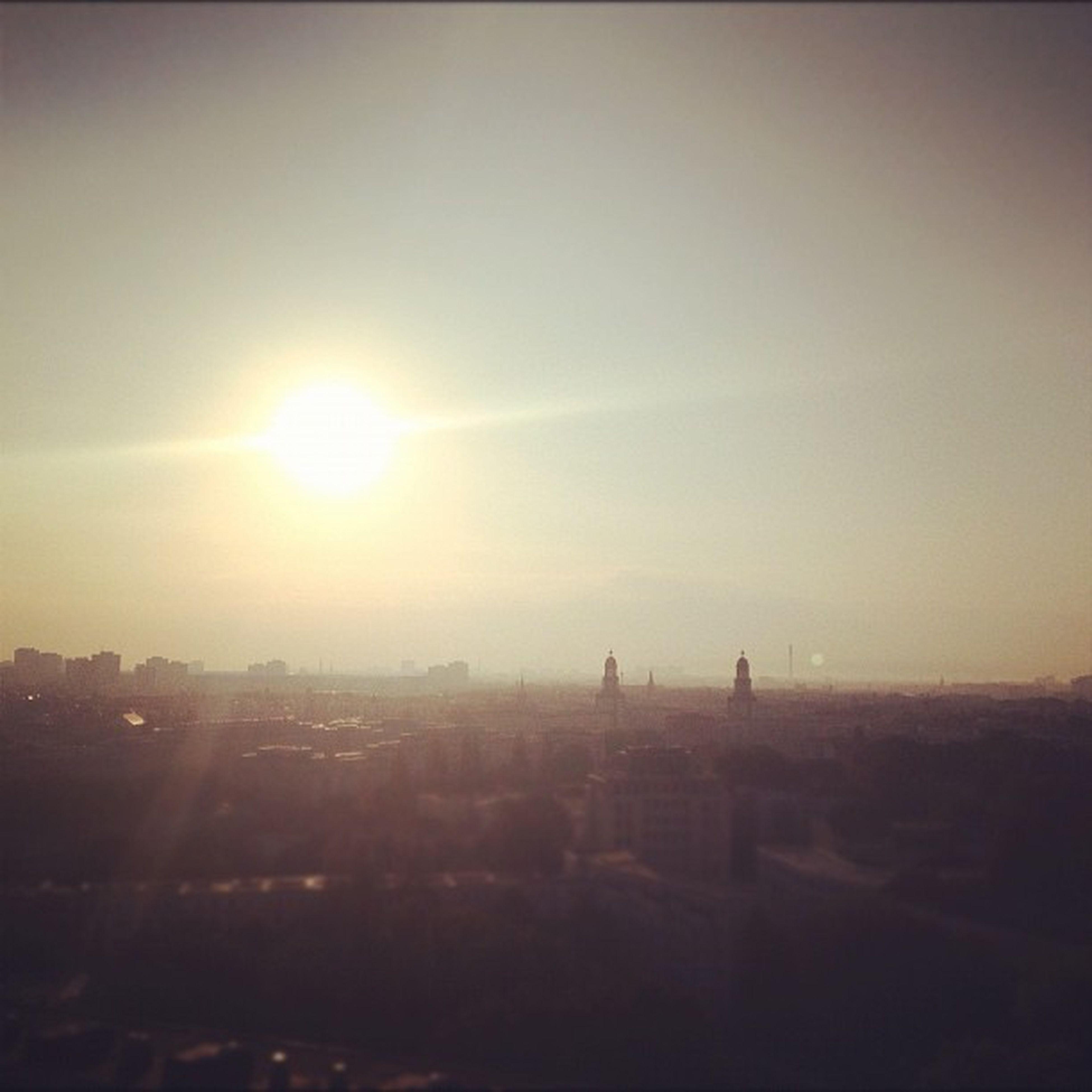 sunset, sun, cityscape, silhouette, building exterior, architecture, built structure, city, sky, sunlight, landscape, lens flare, scenics, sunbeam, clear sky, nature, copy space, outdoors, tranquility, tranquil scene