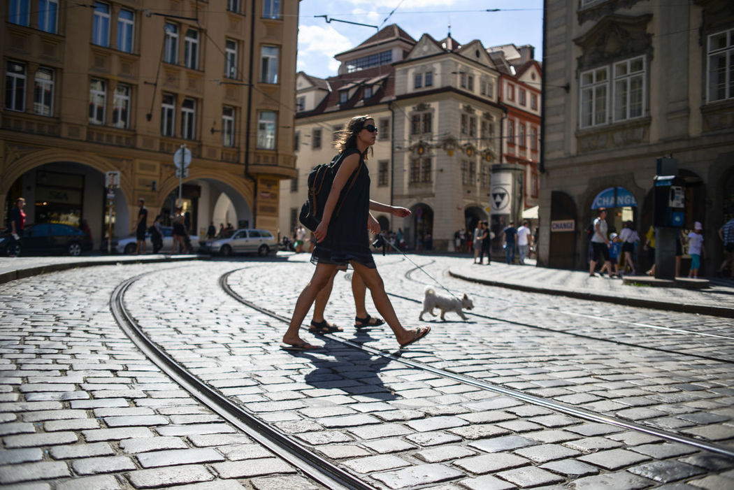 Adult Adults Only Architecture Building Exterior Built Structure City City Life City Street Day Dog Going Out Leisure Activity One Person One Woman Only Outdoors Pair People Pet Street Streetphotography Sunny Women Young Adult What Who Where