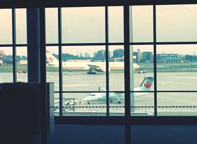 Plane Through The Window Dropping Off my sister at the Airport
