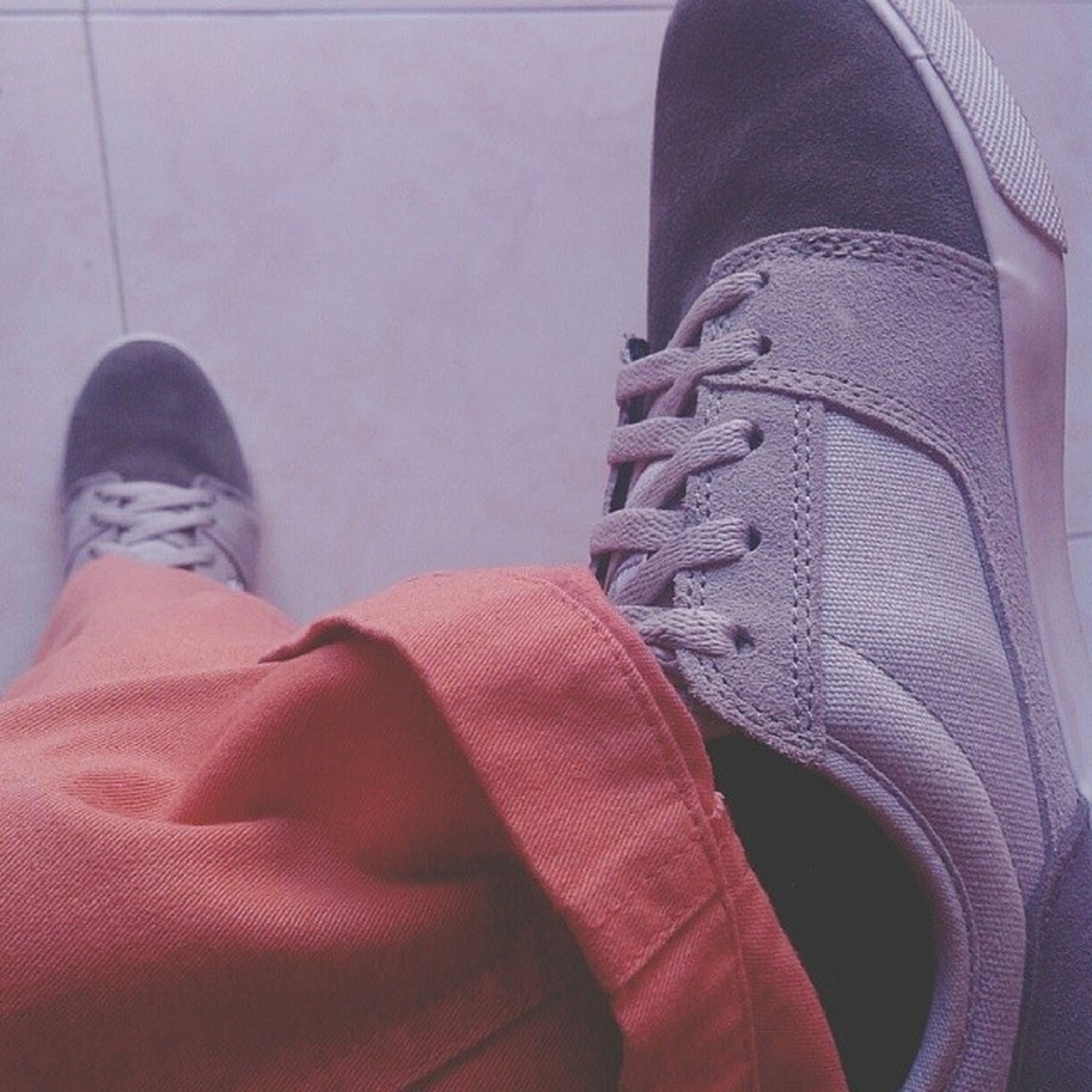 low section, person, shoe, jeans, lifestyles, personal perspective, human foot, standing, footwear, casual clothing, men, fashion, high angle view, leisure activity, indoors, close-up