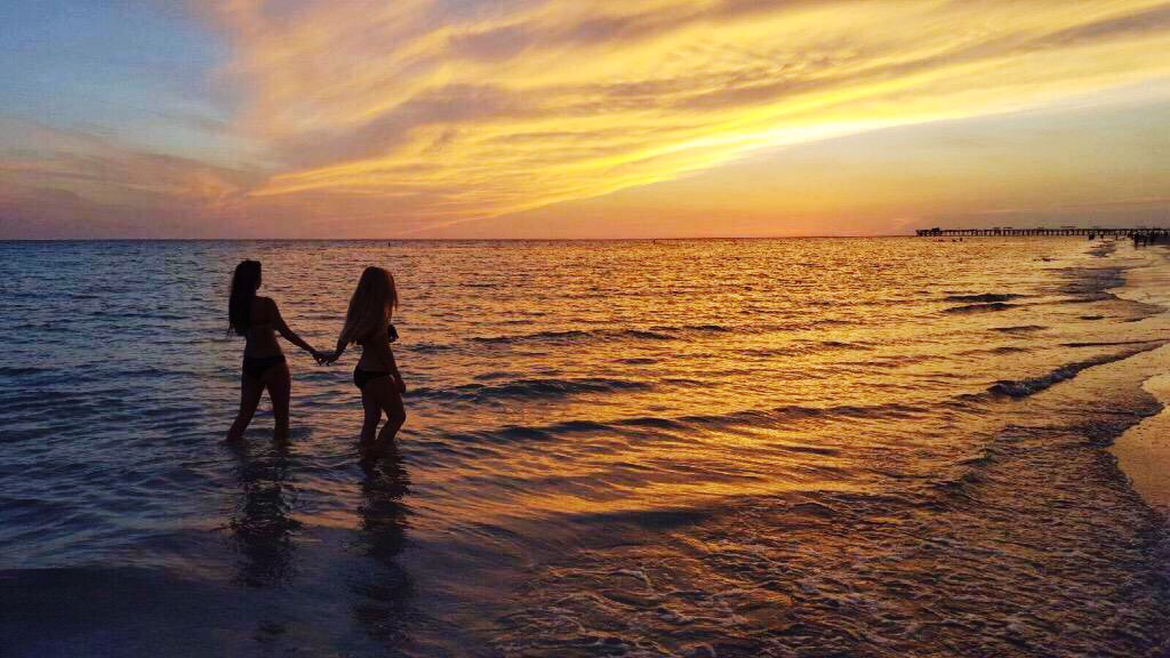 sea, water, sunset, horizon over water, beach, sky, silhouette, shore, leisure activity, lifestyles, scenics, beauty in nature, men, vacations, cloud - sky, reflection, tranquil scene, orange color, person