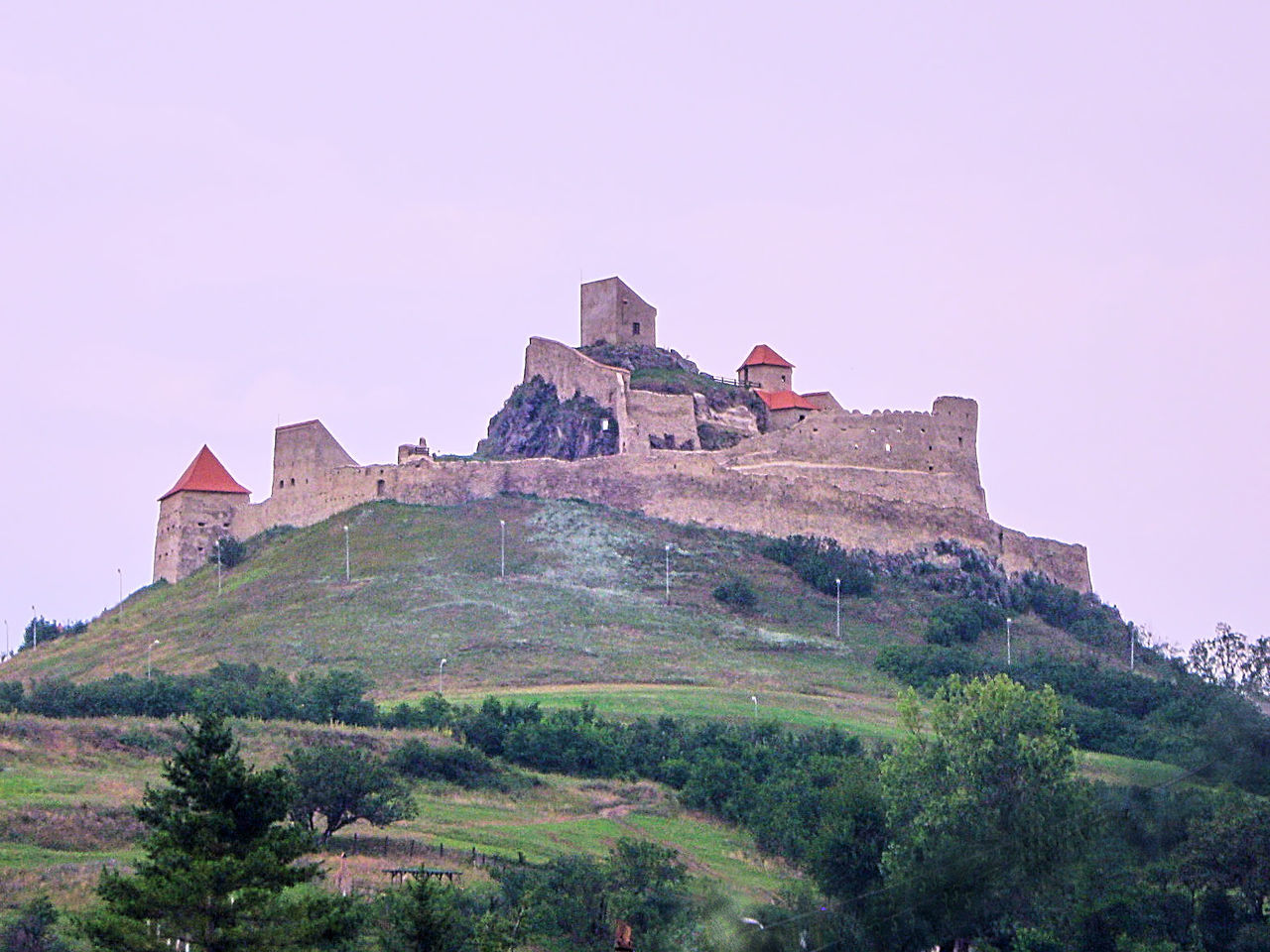 Old citadel in Transylvania, Romania - Architecture Building Exterior Built Structure Castle Cita Clear Sky Day Fortification History Low Angle View Nature No People Outdoors Rupea Castle Sky Transylvania Travel Destinations Tree