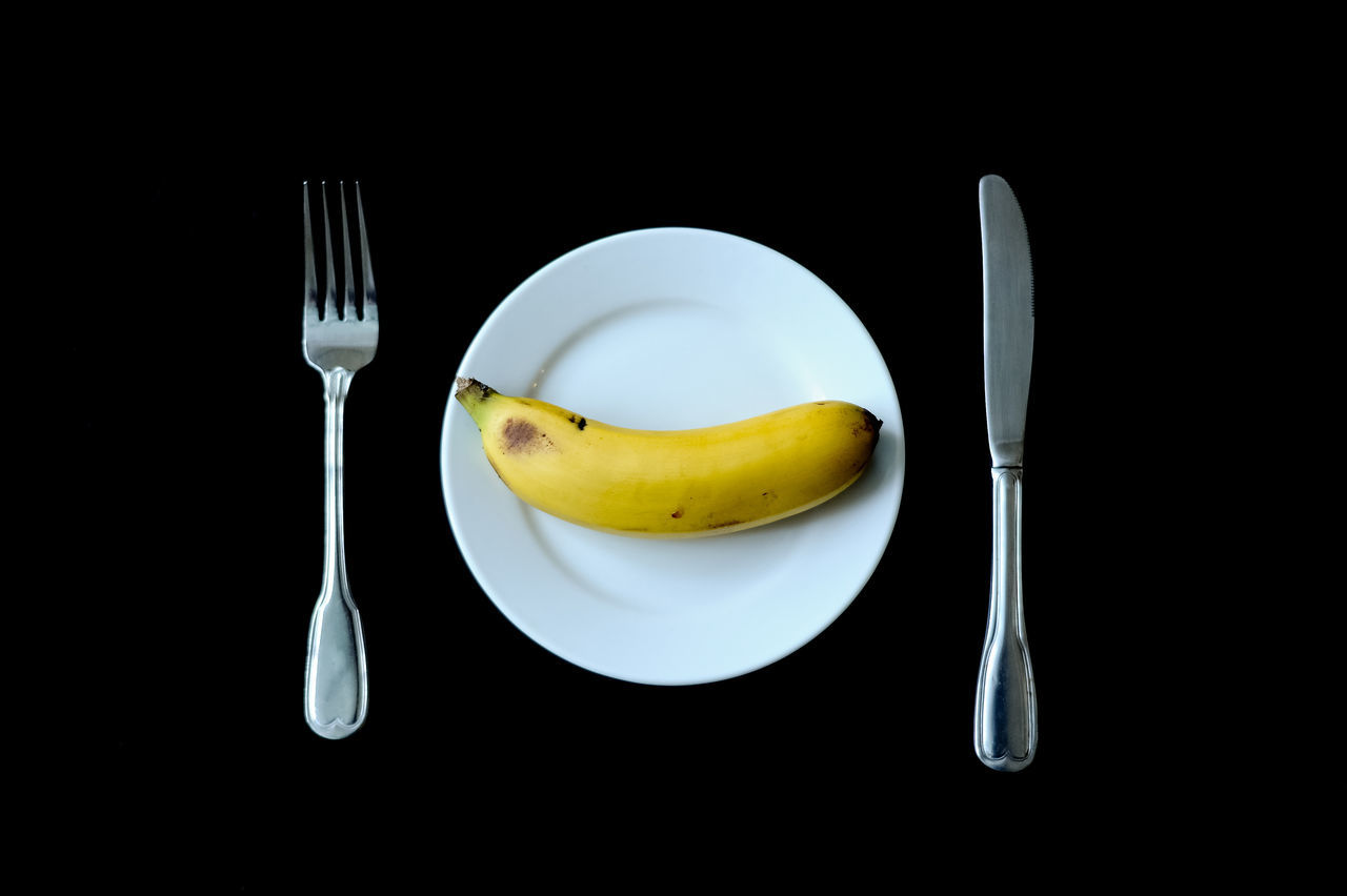 Source of Energy Banana Black Background Close-up Day Eat Healthy Energy Food Food Fork Freshness Fruit Healthy Eating Indoors  No People Plate Ready-to-eat Studio Shot Table Vegetarian Meal Daily Booster