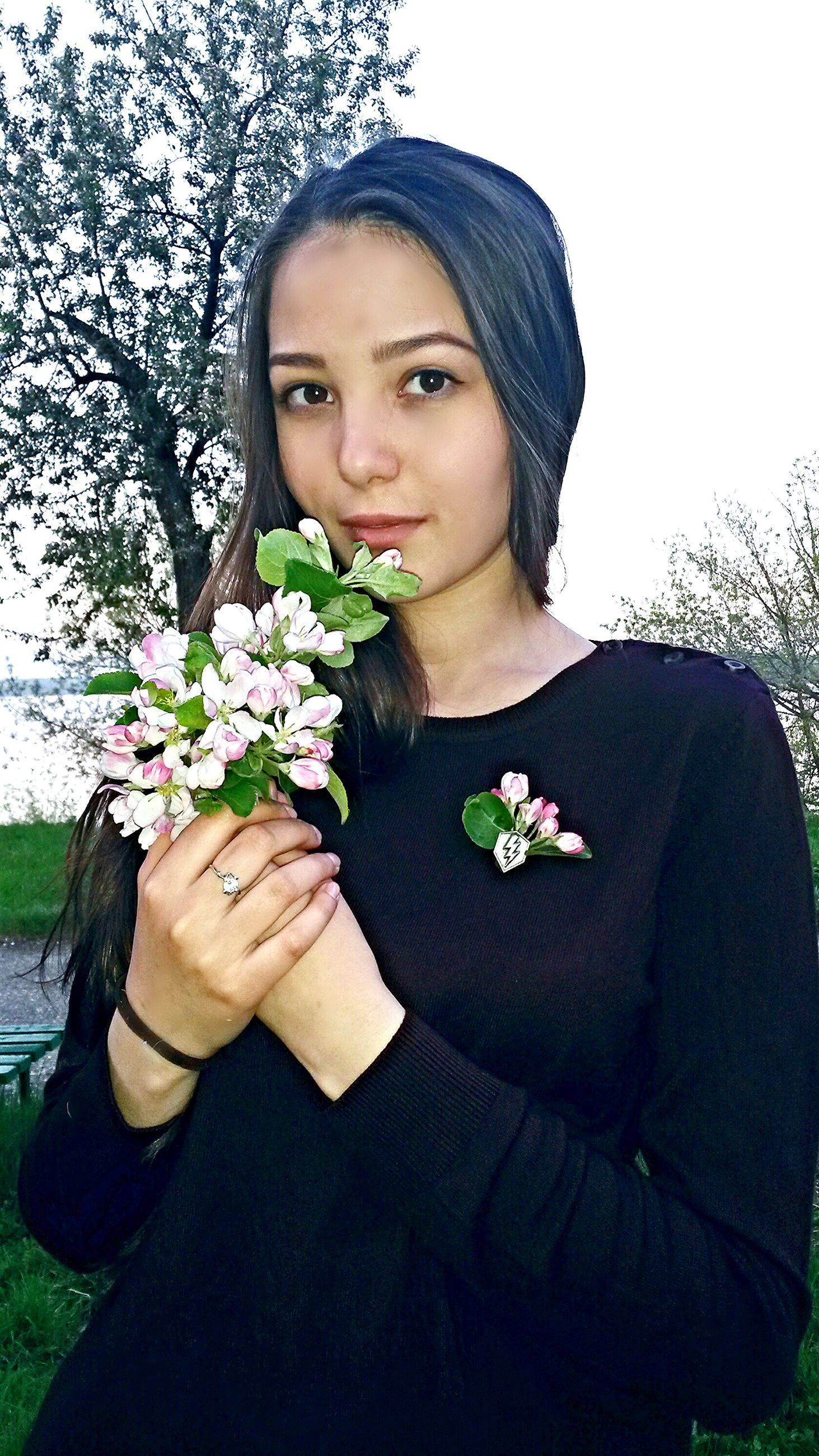 flower, young adult, young women, bouquet, nature, one person, beautiful woman, front view, plant, growth, real people, beauty in nature, outdoors, lifestyles, looking at camera, holding, rose - flower, portrait, leaf, fragility, day, freshness, beauty, flower head, tree, close-up, people