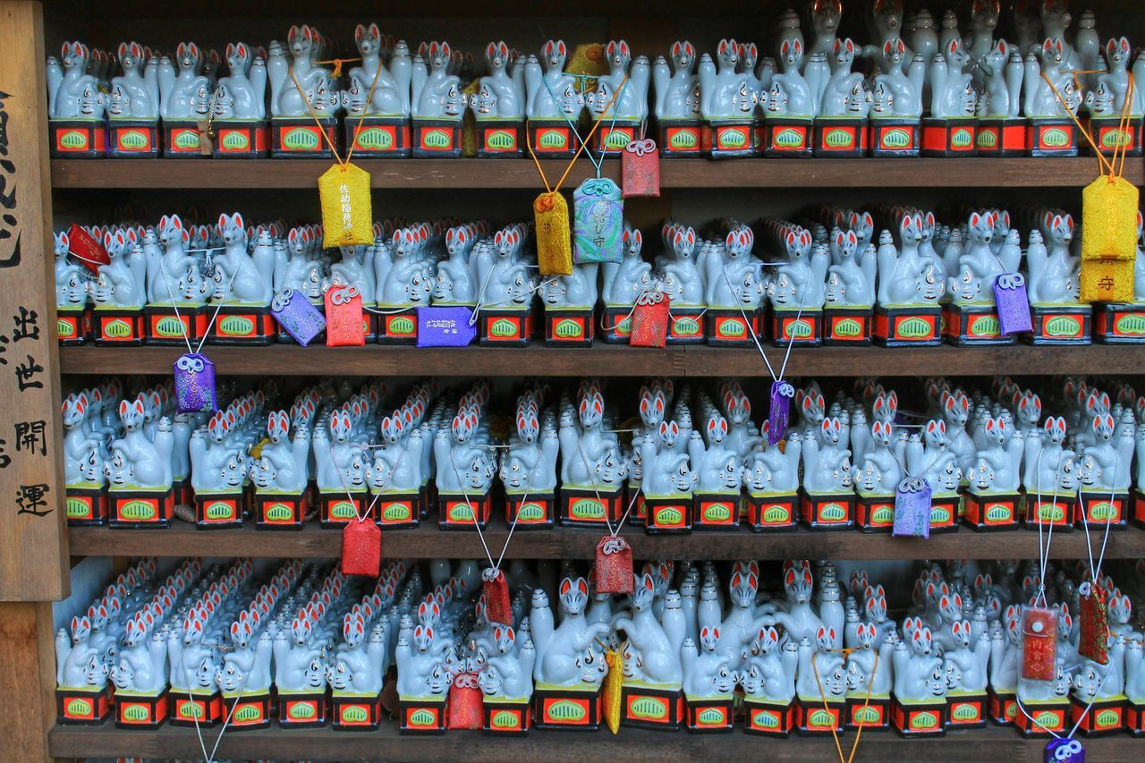 Abundance Arrangement Believe Buddhism Charm Choice For Sale Fox God Good Luck In A Row Japan Large Group Of Objects Lucky Charms Multi Colored No People Omamori Prayer Religion Shelf Shinto Shrine Shintoism Talisman Temple Variation Wish