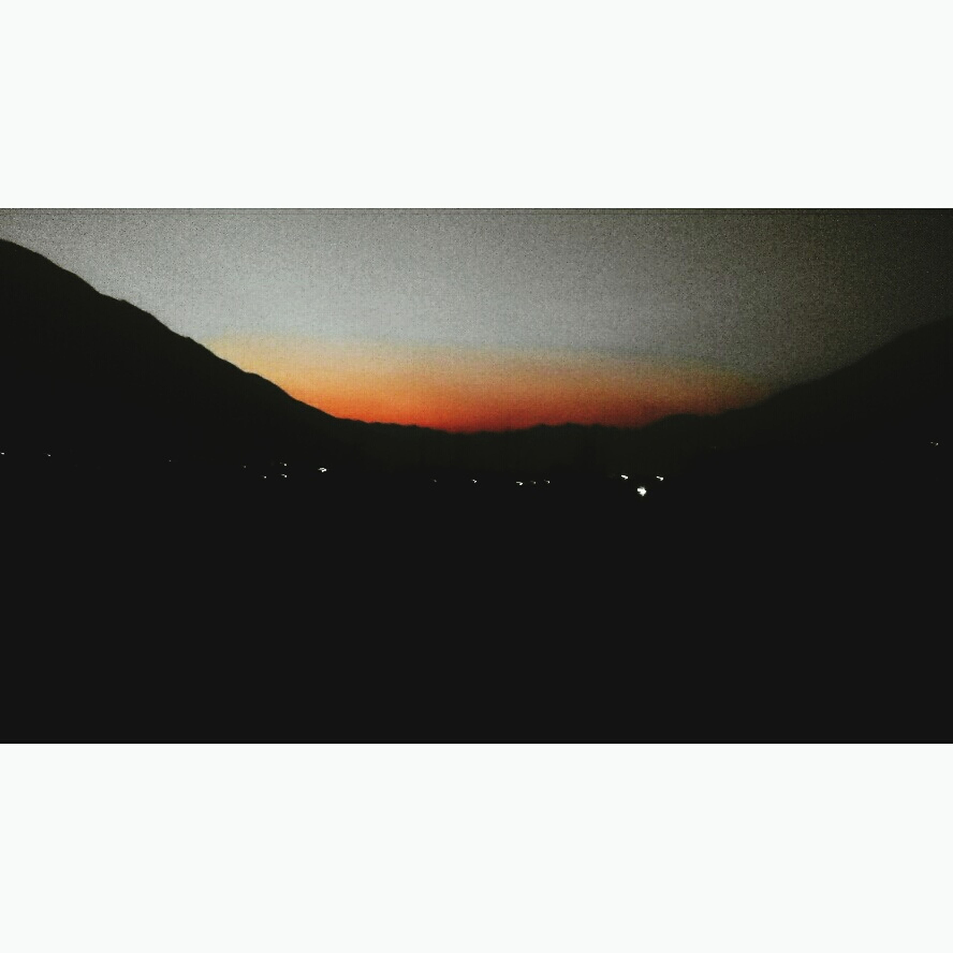 transfer print, auto post production filter, silhouette, mountain, copy space, sunset, scenics, sky, tranquil scene, beauty in nature, tranquility, mountain range, night, dark, dusk, nature, clear sky, illuminated, idyllic, outdoors