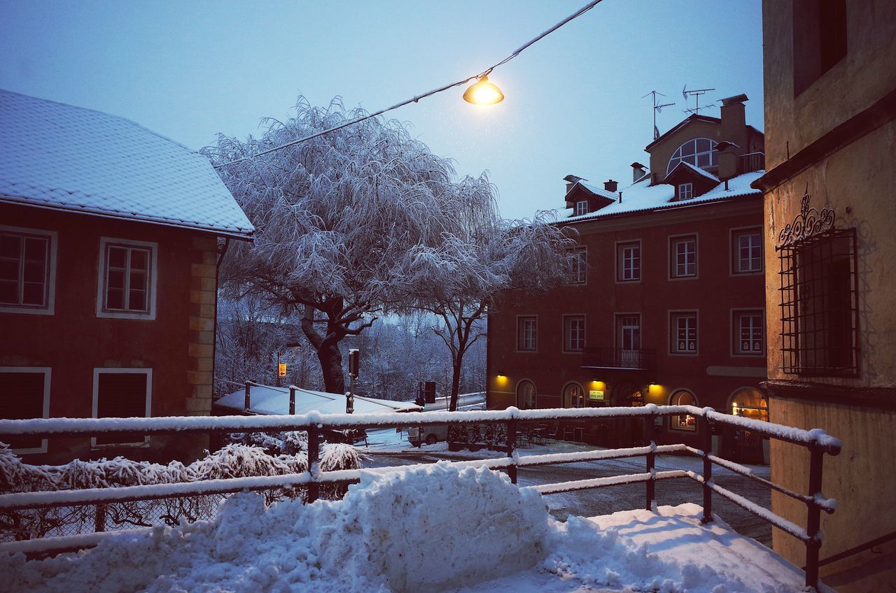 architecture, building exterior, winter, built structure, snow, cold temperature, weather, house, street light, tree, lighting equipment, outdoors, residential building, no people, illuminated, nature, clear sky, day, sky, city