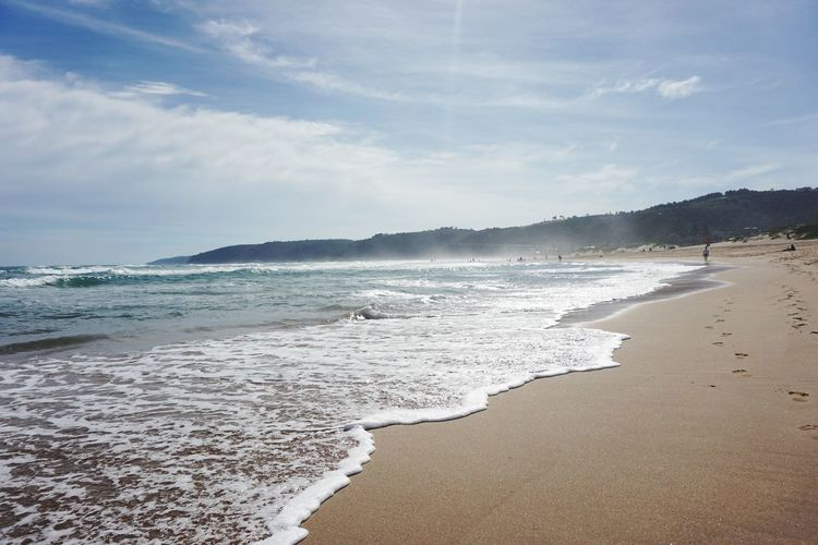Sea Wave Beach Surf Sand Shore Water Nature Sky No People Power In Nature Outdoors Motion Horizon Over Water Day