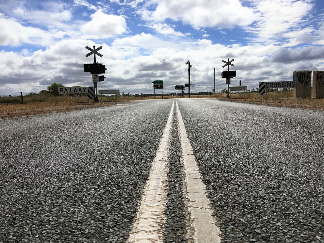 Australia Cloud - Sky Cloudporn Day Junction Lines Low Angle View Middle Of The Road Nature No People Outdoors Paint Railroad Railway Railway Crossing Railway Signal Railway Track Road Road Road Trip Roadsign Silhouette Sky Tarmac The Way Forward Traveling Home For The Holidays