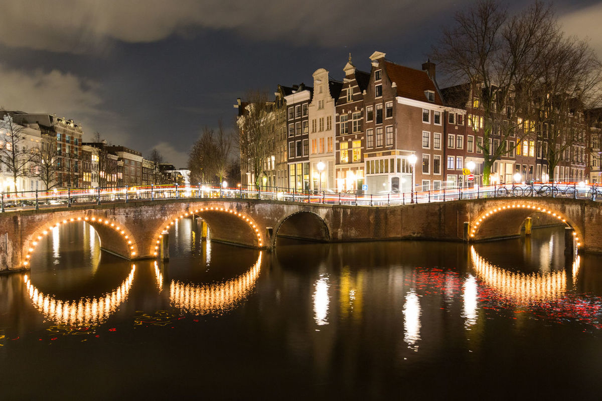 Beautiful night scene in Amsterdam at Keizersgracht and Leidsegracht Amsterdam Architecture Beautiful Bow City Cityscape Keizersgracht Leidsegracht Light Netherlands Reflection Stripes Travel Tree View Attraction Bridge Canal Destination Illuminated Night River Sky Water Waterway
