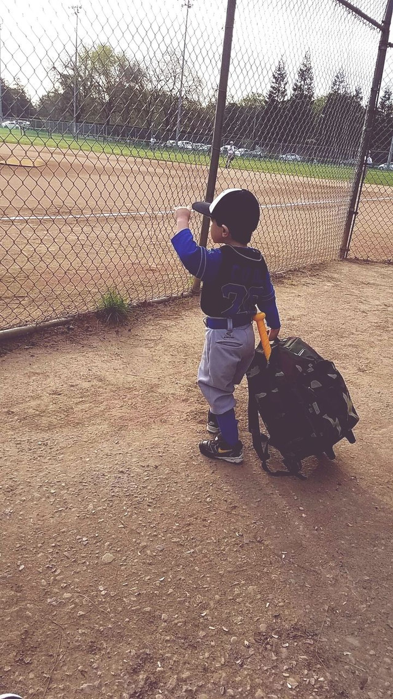 Paying Respect to the game.... Never too young to start Futureballer Childhood Child Boys Baseball - Sport One Boy Only Full Length Children Only Baseball Bat Baseball Helmet Real People One Person Standing Passion