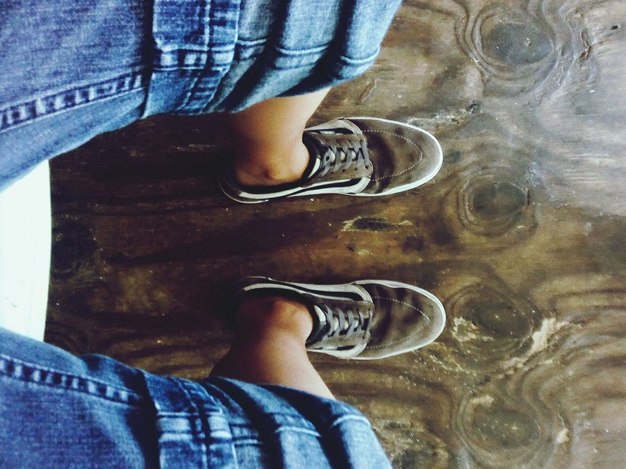 low section, human leg, standing, real people, jeans, one person, shoe, directly above, casual clothing, indoors, high angle view, human body part, men, lifestyles, day, boys, childhood, close-up, water, people