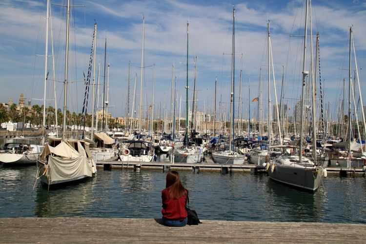 Barcelona Enjoying The View Port De Barcelona  Sitting Outside Tourist Yachts Boat Harbor Mast Mode Of Transport Moored Nautical Vessel One Person Outdoors Sailboat Transportation Travel Destinations Water Waterfront Young Women Breathing Space Your Ticket To Europe Lost In The Landscape Done That. Mobility In Mega Cities Colour Your Horizn