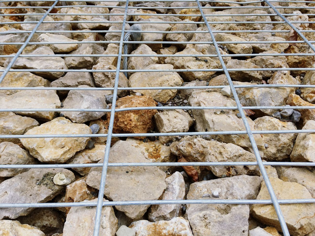 Full Frame Backgrounds Outdoors Day Pattern No People Built Structure Architecture Nature Salt - Mineral Structure Wall Stone Metal Cage Background Stones Boulder Path