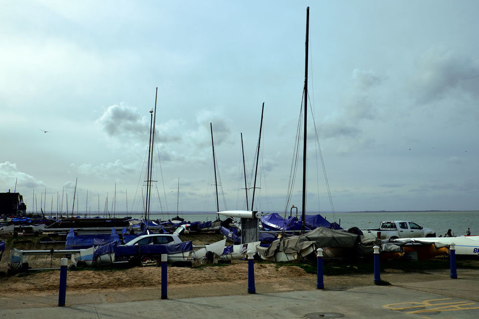 Seaside at Whitstable - Beauty In Nature Cloud - Sky Day England Harbor Landscape Mast Mode Of Transport Moored Nature Nautical Vessel No People Outdoors Outrigger Sailboat Sea Seaside Sky Tranquility Transportation Water Yacht