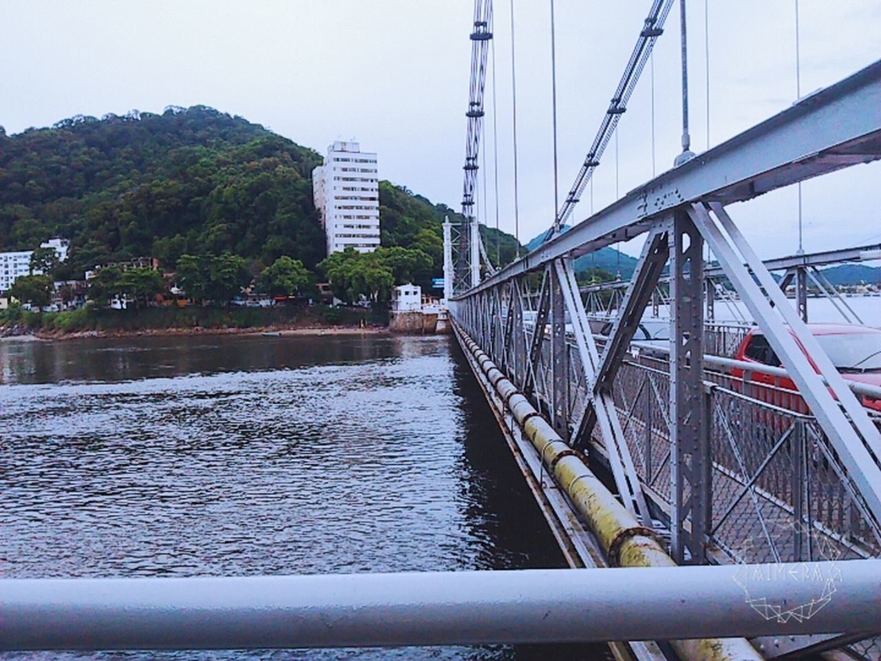 architecture, connection, bridge - man made structure, transportation, day, built structure, water, outdoors, river, no people, building exterior, sky, nature, nautical vessel