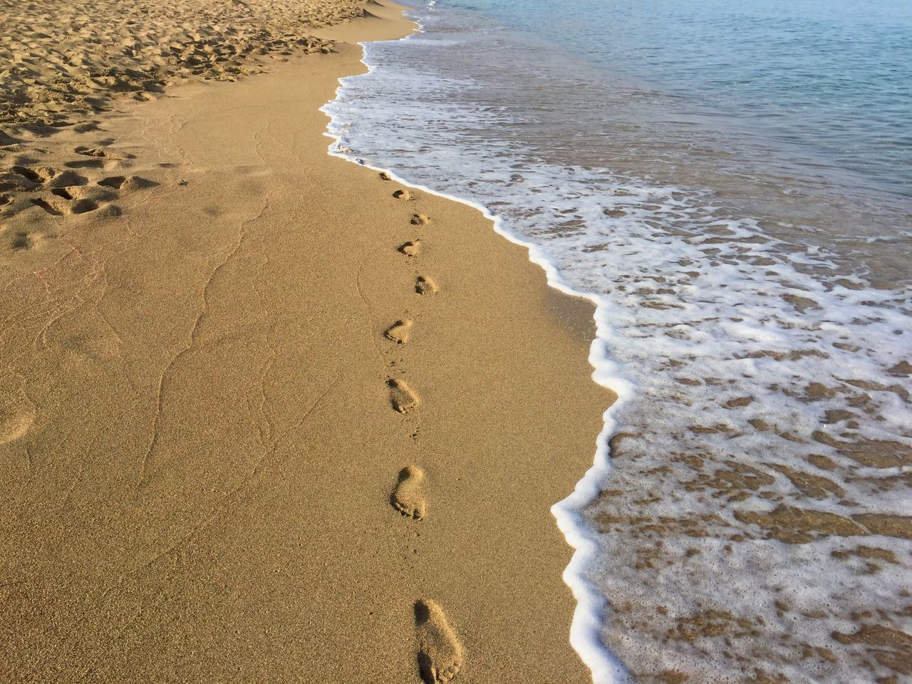 Vanishing footsteps on an empty quiet beach in Greece Beach Sea Sand Wave Water Surf Nature Outdoors Beauty In Nature Perfect Footsteps Tranquility Tourism Travel Greece Crete Travelling EyeEmNewHere