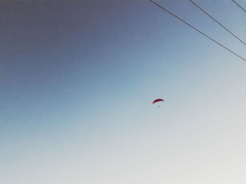Flaying😊😊 EyeEm Best Shots Eyeemsports Flaying Flying Low Angle View Mid-air Parachute Clear Sky Leisure Activity Fun One Person Paragliding Adventure Extreme Sports Day Sky Blue Sport