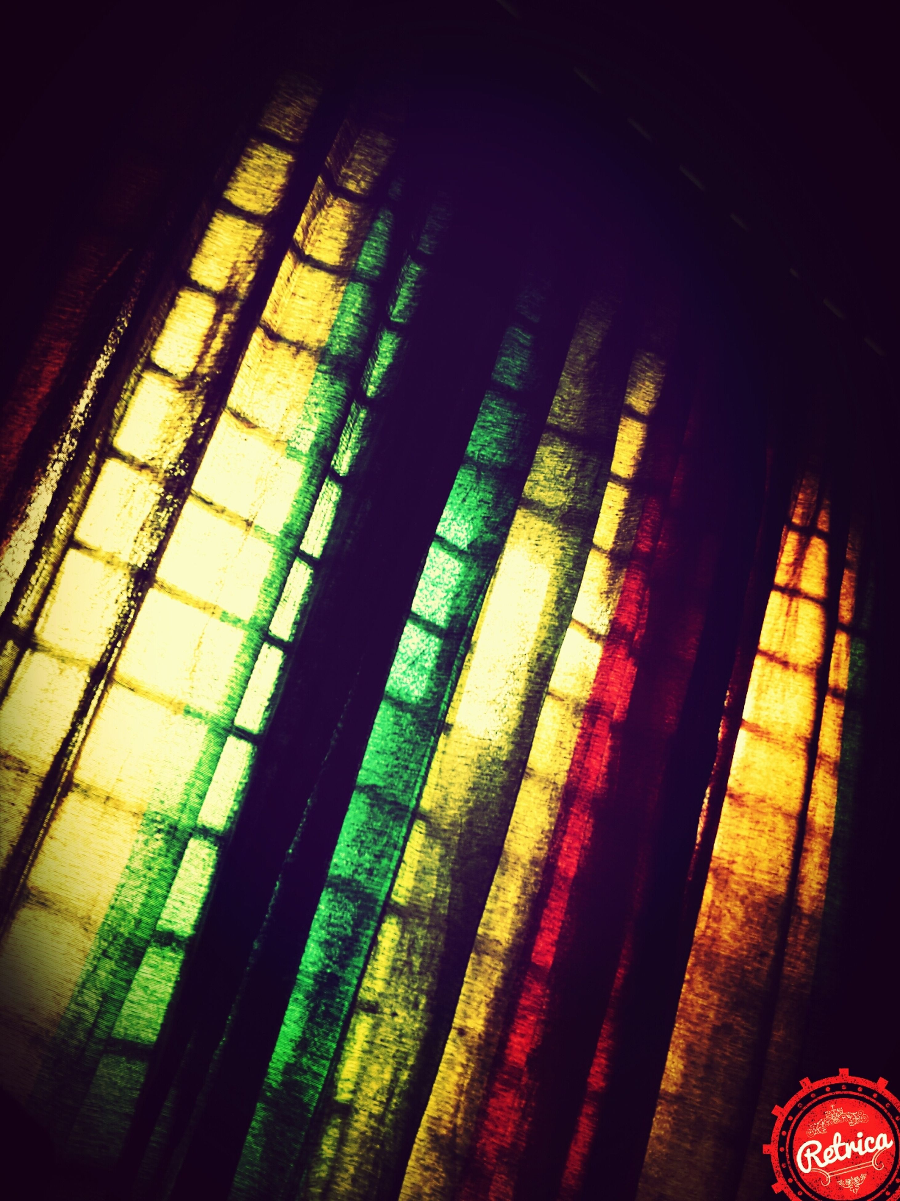 indoors, pattern, illuminated, design, decoration, home interior, no people, window, full frame, still life, hanging, architecture, ceiling, close-up, multi colored, built structure, backgrounds, textile, low angle view, night