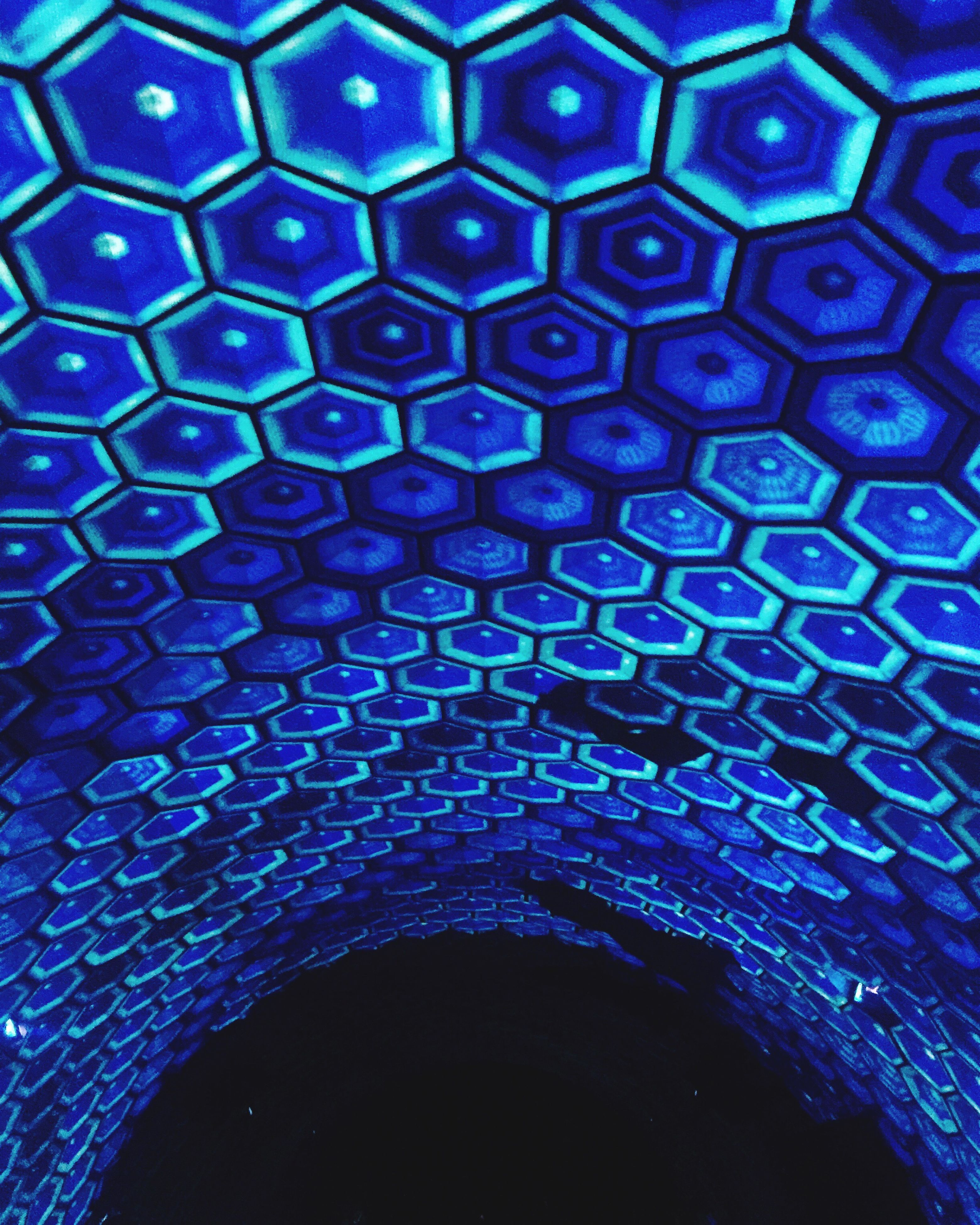 indoors, pattern, full frame, backgrounds, blue, circle, design, ceiling, built structure, architecture, textured, abstract, geometric shape, low angle view, shape, illuminated, no people, close-up, repetition, architectural feature