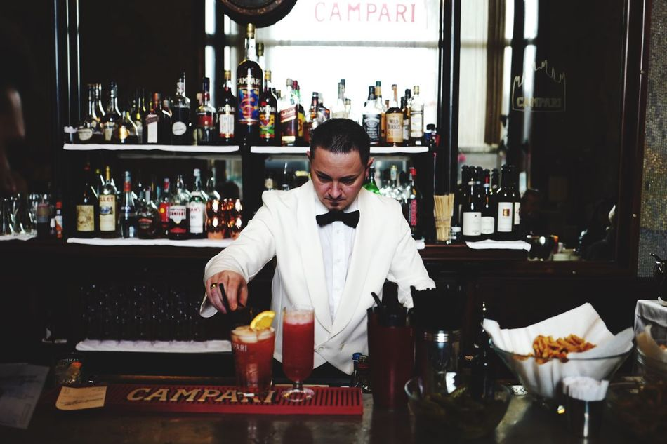 this is Campari. One Person Bartender Occupation Food And Drink Serving Food And Drinks Bar Counter Adults Only Men Bar - Drink Establishment Preparation  Bow Tie Adult Working Service Indoors  Happy Hour