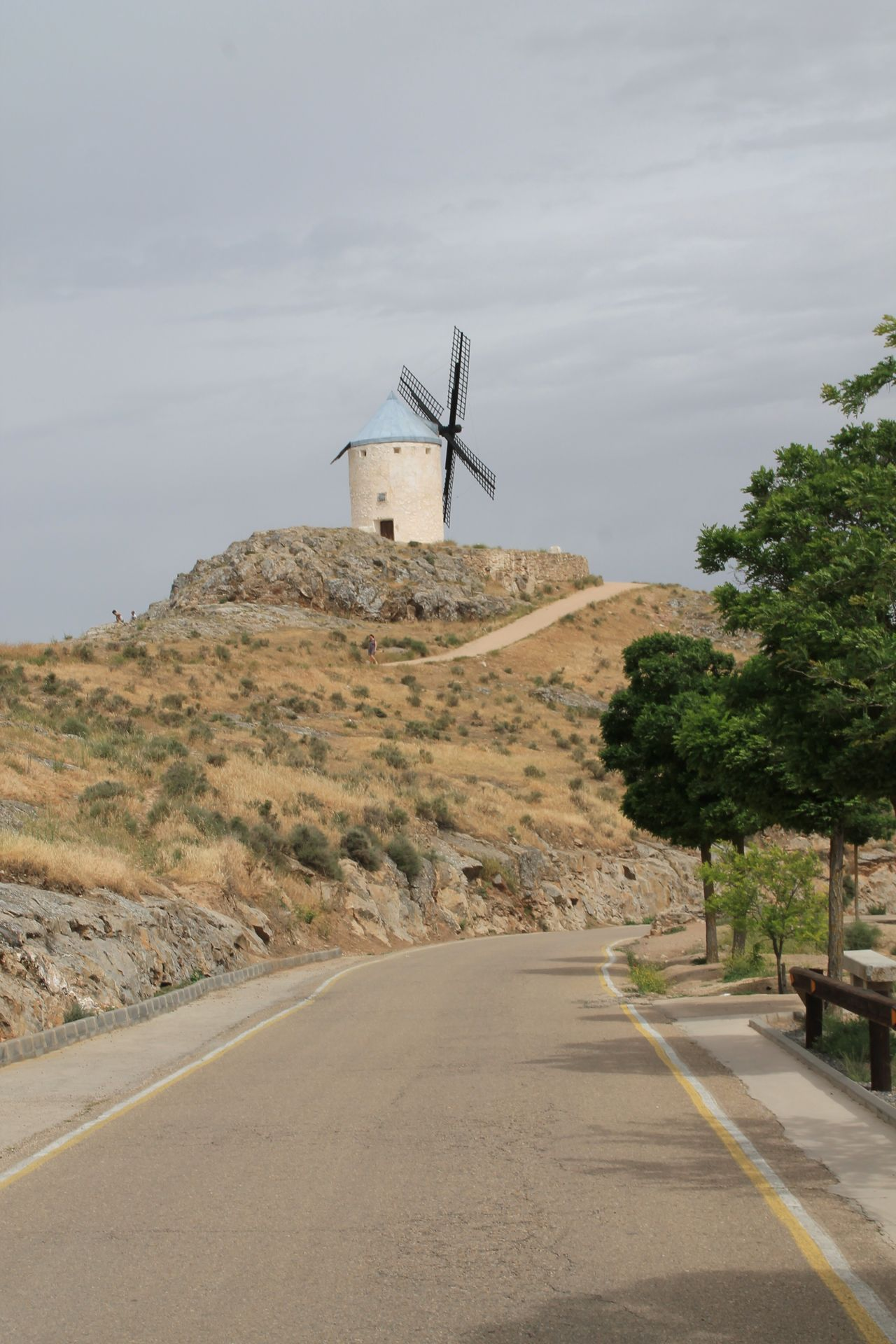 Windmill Wind Power Alternative Energy Wind Turbine Traditional Windmill Built Structure Consuegra Windmill Nature La Mancha Travel Destinations Beauty In Nature Check This Out Hanging Out Cloud - Sky Road Architecture Sky Day The Way Forward No People Outdoors Nature Building Exterior Rural Scene