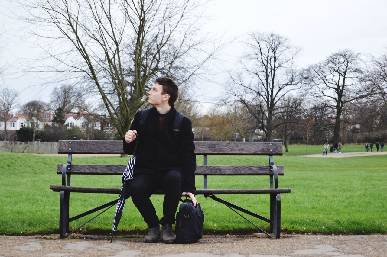 Beautiful stock photos of man, 20-24 Years, Bag, Bare Tree, Bench
