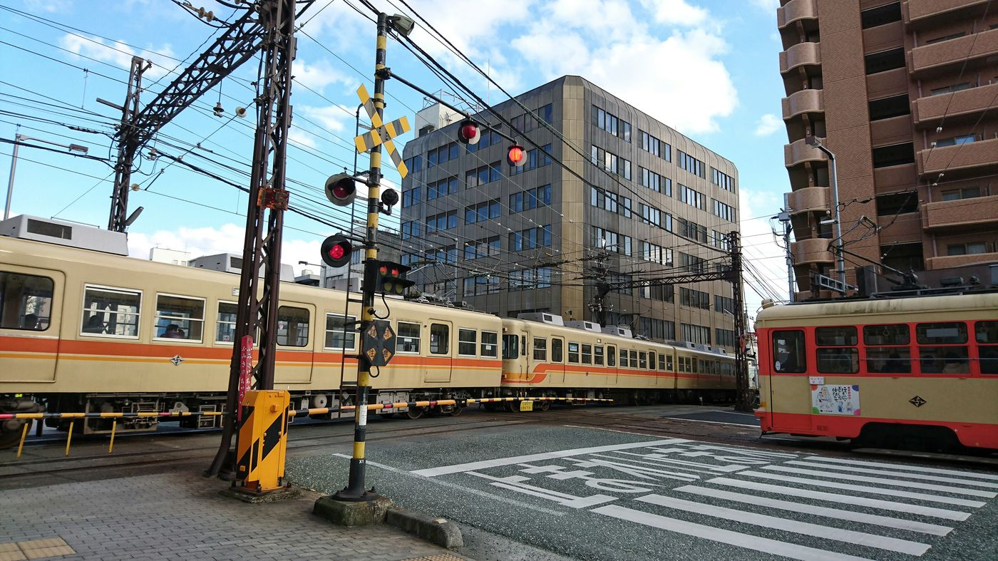 Train Tram Crossing Rail Road On The Road Matsuyama Cityscape Travel Photography From My Point Of View Railroad Crossing 電車 路面電車 路面電車が走る街 松山