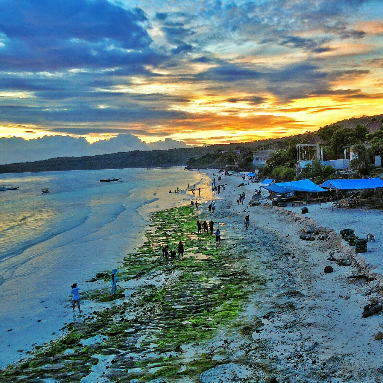 nature, water, scenics, beauty in nature, sunset, sky, real people, sea, vacations, outdoors, tranquility, cloud - sky, leisure activity, tranquil scene, beach, lifestyles, large group of people, men, travel destinations, women, swimming, day, people