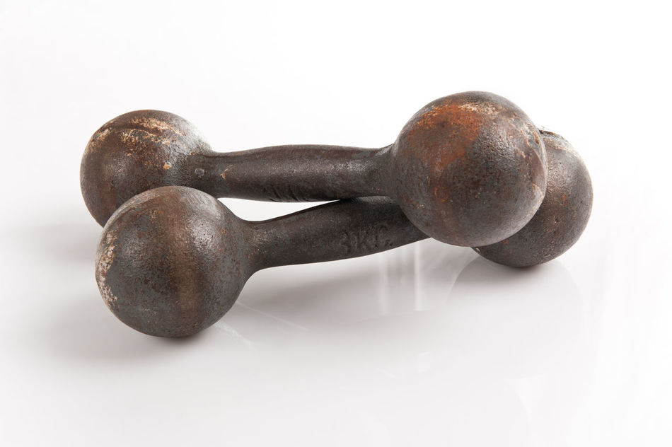 Old steel dumbbells weights black objects on white background in horizontal orientation, nobody. Barbell Barbells Dumbbell Dumbbells Equipment Exercise Exercising Fitness Gym Gym Time Heavy Iron No People Object Sport Steel Weight Weights White Background