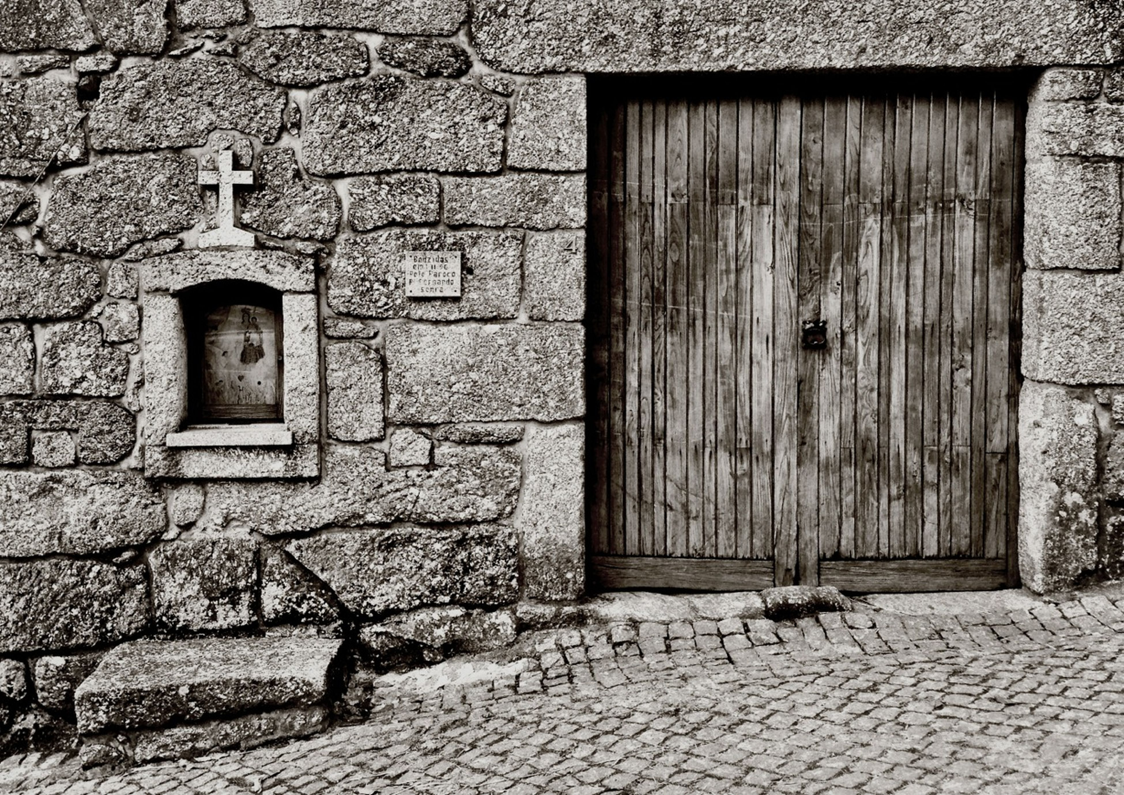 architecture, building exterior, built structure, brick wall, stone wall, door, house, window, wall - building feature, old, cobblestone, closed, wall, entrance, day, outdoors, residential structure, facade, no people, building