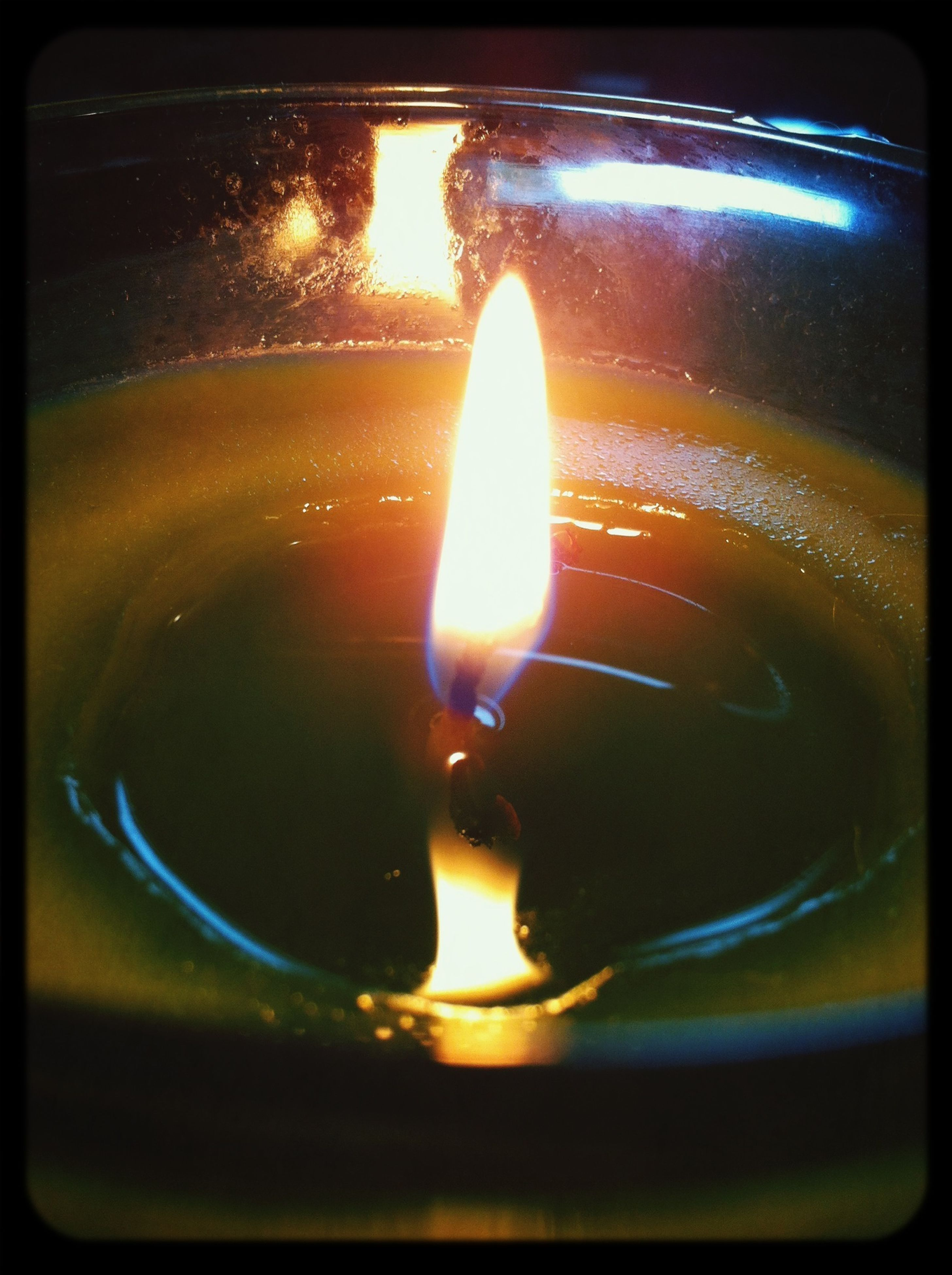 flame, burning, heat - temperature, glowing, fire - natural phenomenon, transfer print, close-up, reflection, indoors, fire, auto post production filter, glass - material, orange color, transparent, dark, motion, illuminated, no people, candle, night