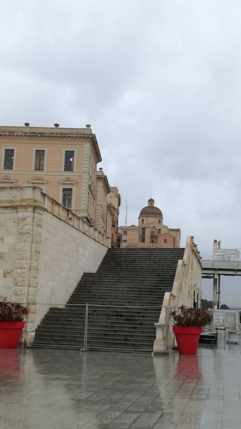 walking in the rain Sardinia Sardegna Italy  Bastione Di Saint Remy Architecture Water History Business Finance And Industry Ship Sea Built Structure Outdoors Day Sky No People City